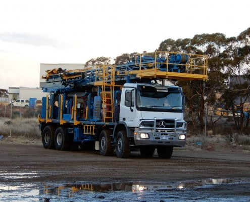 Jarahfire Schramm T685 exploration drill rig parked in the yard