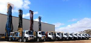 Drill rigs parked in the yard with masts up